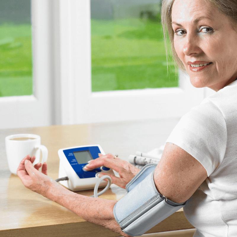 woman taking her blood pressure - have high blood pressure?