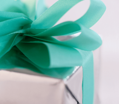 Gift with sea-foam green bow - heartfelt gifts for caregivers.