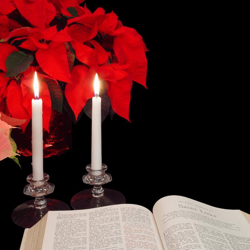 open Bible, candles, poinsettia