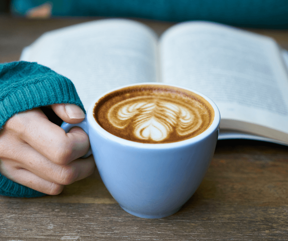 relax w a book - and coffee with decoration in cream