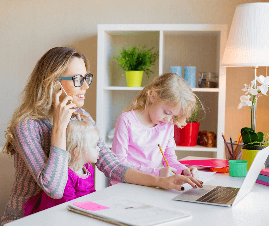 mom on phone at laptop w 2 kids on lap - 9 Self-care Tips for Busy Moms kids at laptop