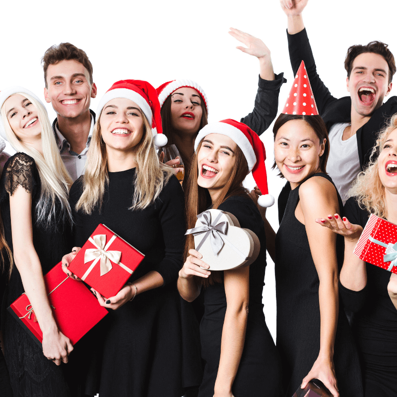 People smiling in Christmas party group