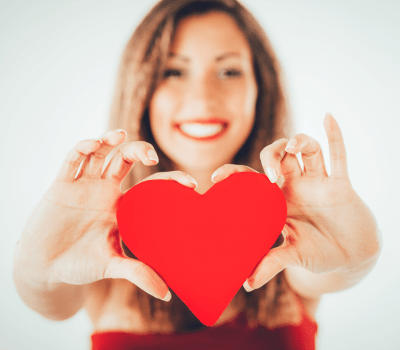 happy woman holding felt heart - Best Self-care Tips on Valentines Day
