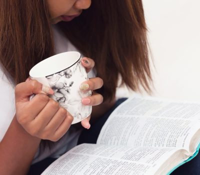 No Time for Self-care Close Up Of Young Lady Studying Her Bible