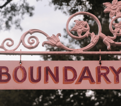 Boundary on pink sign